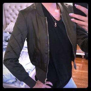 Olive bomber jacket with quilted sleeve detail